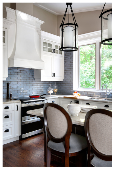 ...The key is to choose a color that pops against the color of the cabinetry, the ceiling and the backsplash, for maximum impact. Design by Laura Stein Interiors; Photography by Brandon Barre via Dering Hall