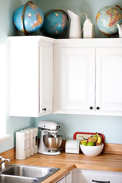 There's no better way to bring this much color and conversation to the kitchen with only a single, repeated, object. Long live globes — new, vintage, whatever! As long as you love 'em. Design and photography by Ashley Ann Photography via Apartment Therapy