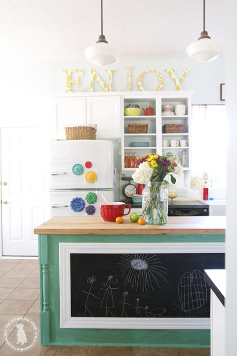 "Looking to bring in a touch of pattern in an unexpected way? Check out The Handmade Home's tutorial on making these fabric-topped letters and create your own decor to spell out your choice of message (we prefer the cheerful ""enjoy"" to the timeworn ""EAT""...but ultimately, whatever makes you happiest.) Photo via The Handmade Home"
