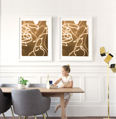 This custom piece of art from Minted plays with light and warmer sepia tones. And, it presents tiny details in a big way, reminding us that not every picture needs to be perfectly composed.