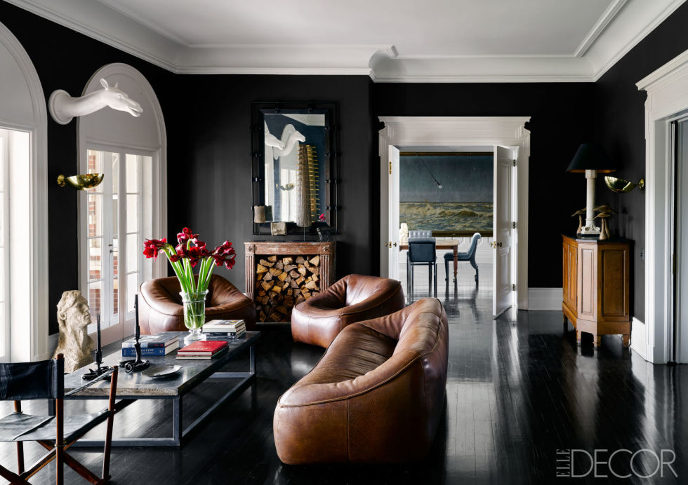 A 1970s leather sofa and matching chairs punctuate 1stdibs founder Michael Bruno's moody sitting room. Tour the entire home.