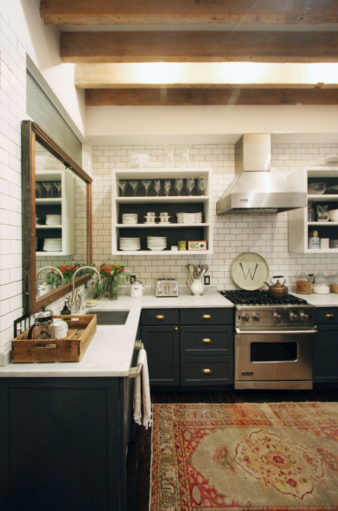 In 2016, Houzz predicts that kitchens will eschew the perfect, polished look for a more eclectic vibe. Instead of only incorporating one or two materials, homeowners will turn to a variety of opposing styles to create a truly personalized space. This Manhattan kitchen, which features a rustic wood ceiling, a white subway tile backsplash, a vintage inspired rug, and shiny white countertops, is a perfect example.
