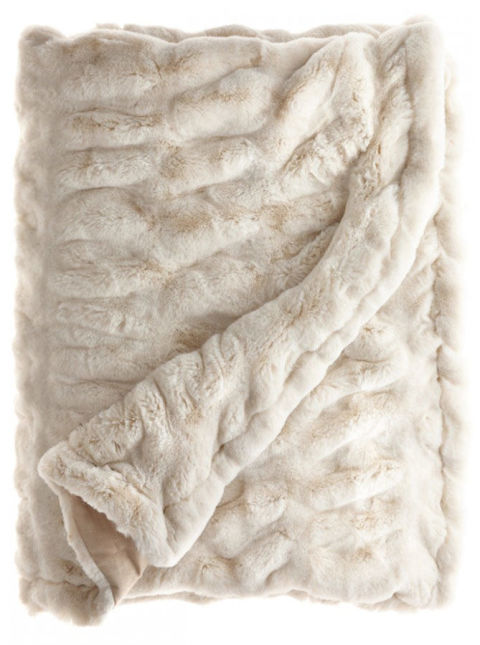 Surviving winter is all about layers, so the more throws the merrier. Pictured here: Faux fur throw, $395; calypsostbarth.com