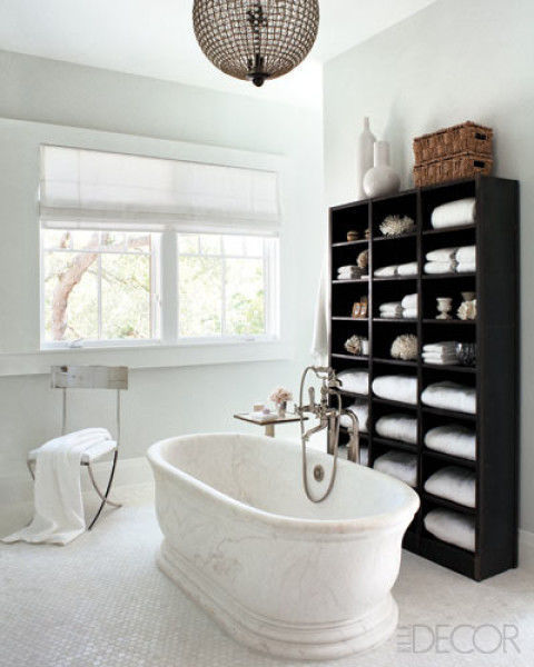 There's no reason you can't bring a bookcase into the bathroom. For a spa-like touch, place one towel in every cubby.