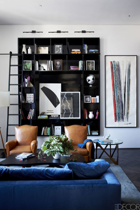 Looking for a way to display artwork that's out of the ordinary? An elevated bookcase does the trick in Jonny Buckland's New York home.