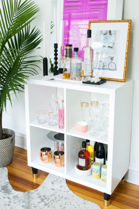 Cocktails, anyone? They're extra easy to fix when the makings are nicely organized, as they are in this bookshelf-turned-bar, spotted on The Everygirl.