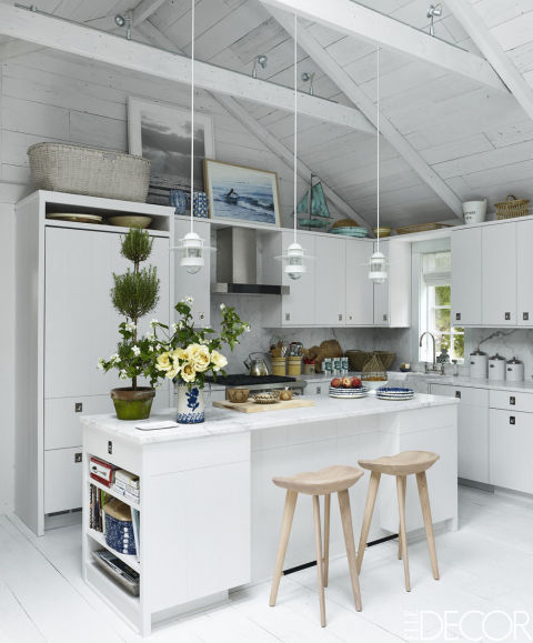 in this cheery hamptons home the kitchen cabinetry is custom made the stools are