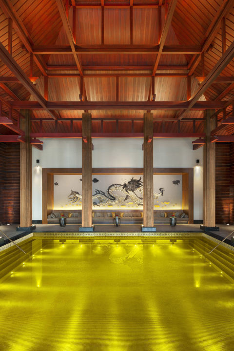 "Lined with thousands of gold tiles and ""guarded"" by a black and white sea serpent, the Gold Energy Pool at the St. Regis Lhasa proves that indoor pools can be just as luxe as an outdoor infinity pool."