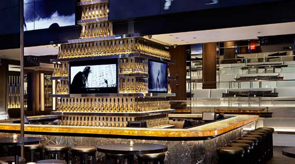 This New York sports bar/club hybrid is exactly what you'd expect from rap mogul Jay-Z:  champagne bottles lining the bar, gold baseball bats all over the walls. They're serving up classic sports bar fare (we want their jumbo breaded onion rings) and curiously named cocktails like A-Rod Steal and Brooklyn Night. Visit the 40/40 Club website here.