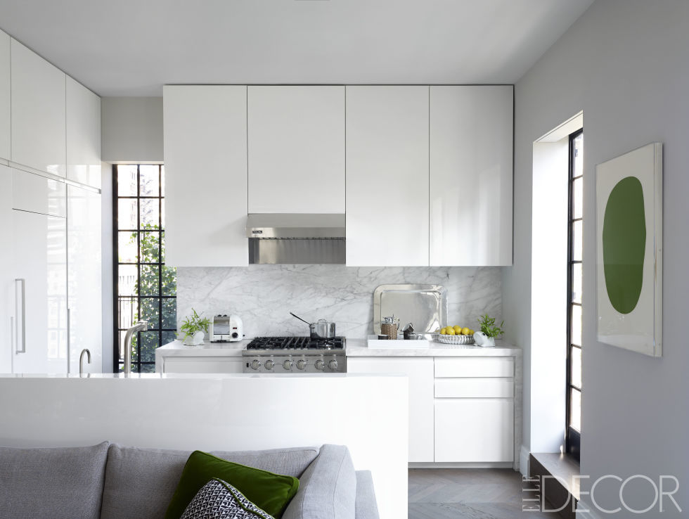 in this new york city home high above the city the kitchens lacquer cabinetry is