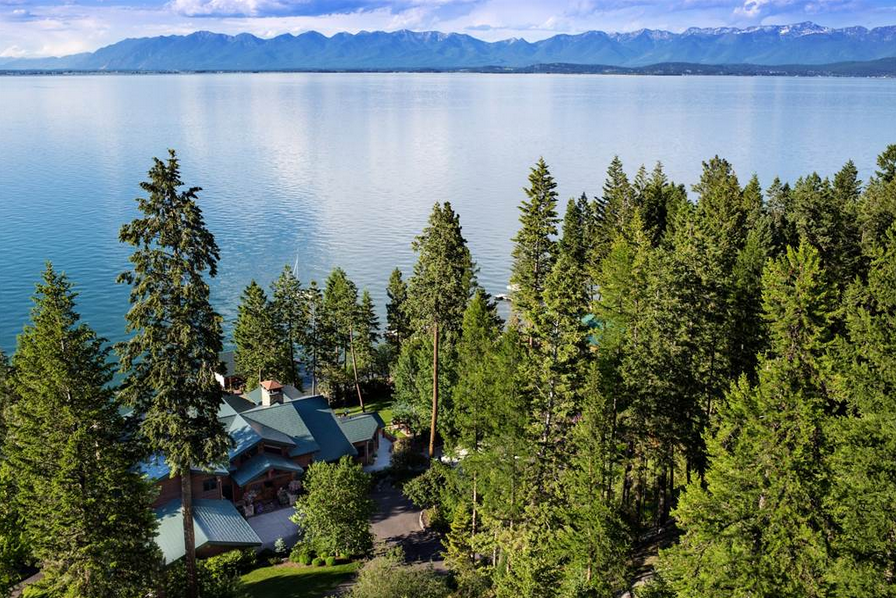 This gated waterfront estate spans in excess of 1 acre and is sited to perfection. Both the dramatic timber-framed main home and guest cottage offer effortless waterfront access with a rare 200 feet of pebble beach on Flathead Lake. Learn more and see inside this property.