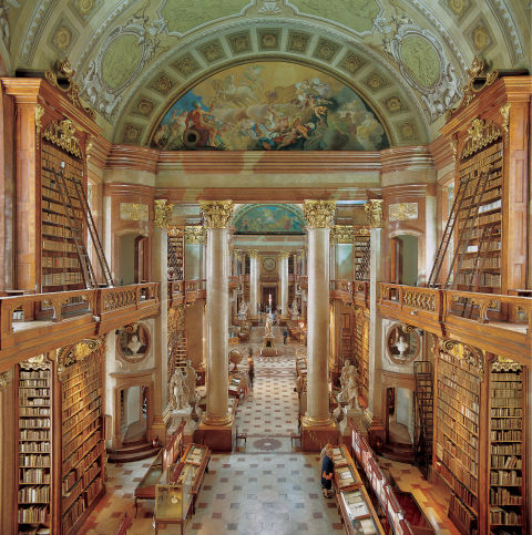 The Austrian National Library in Vienna, Austria, dates back to the middle ages and holds a collective 7 million items. Along with its enormous collection of texts, the structure also holds five museums, making this the largest library in Austria.