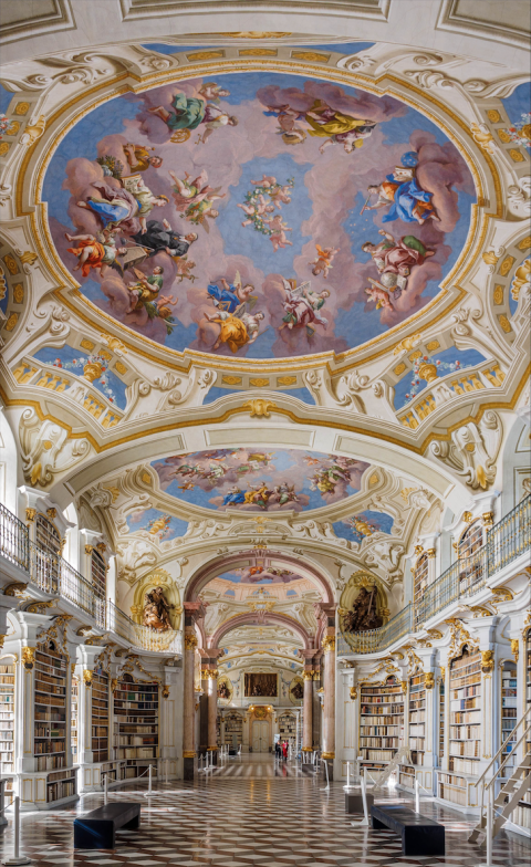 The breathtaking interiors of the Admont Abbey Library in Admont, Austria are true to classic baroque style and manifest the Enlightenment Age ideas of 1776, the year of its completion. As the world's largest monastery library, the building not only holds historic religious texts, but is also home to frescoes, sculptures, and thousands of manuscripts and printed works.