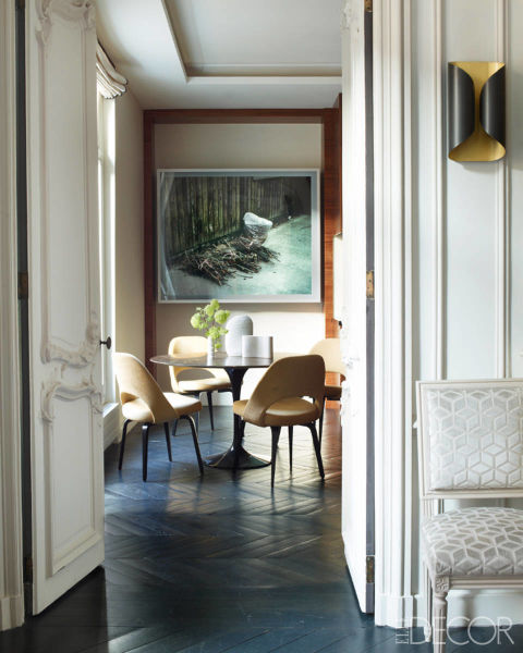 The table and velvet-upholstered chairs in the kitchen are from Knoll, the photograph is by Jeff Wall, and the Louis XVI–style side chair from Onsite Antiques is covered in a Lizzo velvet; the existing herringbone parquet was stained in a custom color.