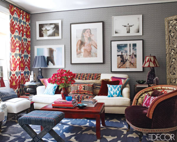 The living room of São Paulo–based designer Sig Bergamin's Manhattan apartment. The ottoman, linen-covered chairs, and velvet armchair, which has a back upholstered in a Braquenié cotton, are by Bergamin. The photograph of Gisele Bündchen is by Michel Comte; the antique bone-inlaid screen was found in India.  See more red, white and blue rooms.