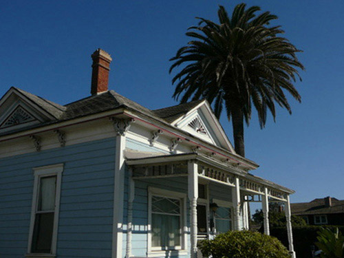 While many people may recognize this adorable two-bedroom Victorian cottage in Oceanside, California as the home of Kelly McGillis' character Charlie from the Tom Cruise flick Top Gun, the property has an interesting and storied past. It was built in 1887 by a man named Dr. Henry Graves, and according to an article on Zillow.com, it's one of the oldest beach cottages in San Diego County. The home was declared a historic property in 2005; the city of Oceanside has approved a $209 million dollar luxury hotel project set to break ground next year that will incorporate the recently restored bungalow perhaps as a gift store or coffee shop, according to the U-T San Diego.