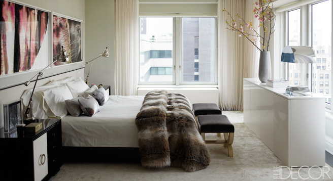 "If the goal is to spend a lot of time in bed, it only makes sense to outfit it with luxe items, like in this master bedroom designed by Kelly Behun. ""A sexy bedroom has lots of luxury bedding,"" says designer Cathy Hobbs."