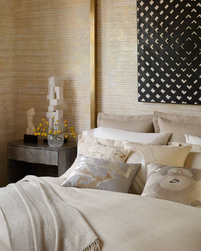 """A wallpaper with depth and dimension can add color and spice to the bedroom,"" says Amy Lau. In this Kelly Wearstler-designed room, she says ""the mix of neutral hues and metallics creates an element of sophistication."""