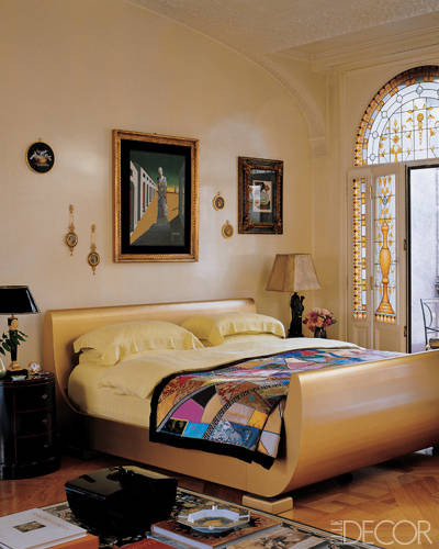 Known for her over-the top, exuberant style, Donatella Versace's Milan bedroom is an eclectic—yet surprisingly restrained—combination of classic and modern. The grand space features a metal bed by Julian Schnabel, a black lacquer side table by Versace Home  and Giorgio de Chirico's painting Il Grande Metafisico.