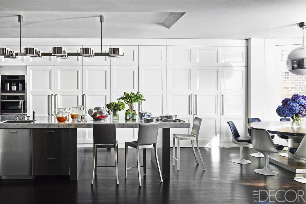 custom made lacquer cabinetry lines a wall of the kitchen in this manhattan townhouse