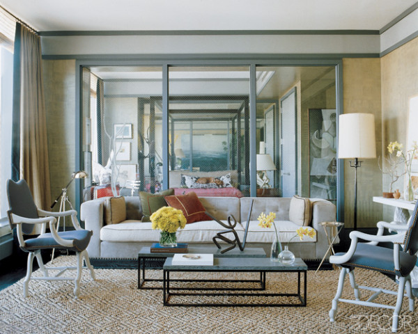 With the right amount of space, two tables can be twice as nice. An eye-catching sculpture adds height and drama.